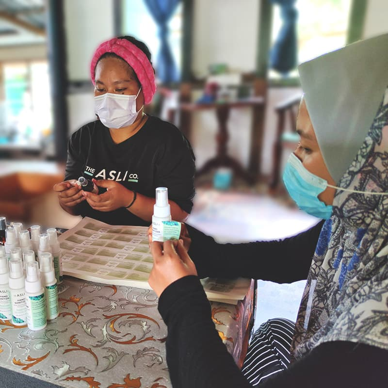 Orang Asli ladies working on sanitizer